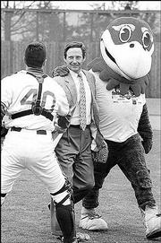 A Jayhawk escorts Kansas University booster Forrest Hoglund, center, off the Hoglund Ballpark field in 1999. Hoglund threw out the first pitch during dedication ceremonies.
