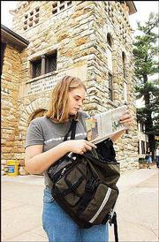 Abby Mills, a Kansas University senior-to-be from Overland Park, looks through her backpack during the first day of classes last August in front of Stauffer-Flint Hall.