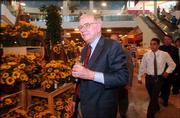 Warren Buffett, the second richest man in the world, oversees the offerings at his newest Nebraska Furniture Mart store. Buffett was at the Kansas City, Kan., store Friday as part of its grand opening celebrations. Buffett said he expected the store to generate more than $350 million a year in sales.