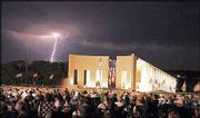 A lightning strike lights up the sky behind the Dole Institute of Politics during dedication events July 21. The 28,000-square-foot building was dedicated on Bob Dole's 80th birthday July 22.