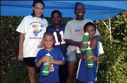 A group of young Kansas University football fans attends the end of the team's practice. Back row, from left, are Erica Aldridge, Alex Greene and Tiffany Greene; front row, from left, are Travis Aldridge and Darrian Aldridge. The Lawrence youngsters attended Kids Day Sunday at the practice fields.