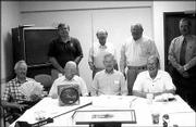 Lawrence Presbyterian Manor's Golf Committee discusses auction items for the Soup and Pie Supper. Back row, from left, are Mike McCormick, Ned Cushing, C.O. Nauman and Dave Bogner; front row, from left, are Warren Corman, Russ Mosser, Martin Jones and Jack Hinton. The group met Aug. 7 to talk about the fund-raiser, which will be from 5 p.m. to 7:30 p.m. Sept. 16 at the manor, 1429 Kasold Drive. The 10th annual golf tournament will be Sept. 18 at Eagle Bend Golf Course. The deadline for registration is Sept. 12.