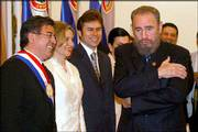 New Paraguayan President Nicanor Duarte, from left, his wife Gloria Penayo, Vice President Luis Castiglioni and Cuba's Fidel Castro joke at the Government House in Asuncion, Paraguay. Duarte took office Friday as Paraguay's 47th president.