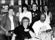 David Brzoska, front right, enjoys a retirement celebration at Pachamama's restaurant in Lawrence. From left are Janice McClure, Judy Brzoska, Teresa Angelone, Rhonda Whiteside and Sheryl Nettleton. Brzoska plans to devote more time to his entomology research in affiliation with Kansas University.