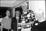 From left, Suzanne McColl, Lucy Price, Robert McColl and Roxie Harmon attend a reception to celebrate the retirement of dentist David Brzoska. More than 350 people attended the reception Aug. 2 in the atrium of the office, 826 Iowa.