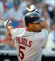Albert Pujols raps a single off Phillies' pitcher Vicente Padilla in the first inning Friday, upping his hitting streak to 29 games.