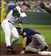 Royals third baseman Joe Randa reacts to missing a tag on Minnesota's Matt LeCroy in the third inning. LeCroy went from first to third on a double by Jacque Jones during the Twins' 9-2 victory Friday night at Kauffman Stadium in Kansas City, Mo.