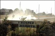 Residents in the Hesper Heights subdivision, at North 1100 and East 2300 roads south of Eudora, are fed up with the amount of dust from gravel roads in front of their homes. They've asked Douglas County commissioners to allow them to have the roads paved.