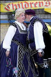 The Duke of York leans in to tell the Duchess a secret at the Kansas City Renaissance Festival. The annual event begins next weekend.