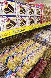 Twinkies await sale on a shelf in a Wonder Bread Outlet store in Lawrence. More than 70 years after the debut of the world famous Hostess Twinkie, the current baker of the treats is struggling as competitors, including Krispy Kreme Doughnuts, Inc. eat away at the baked goods industry profits.