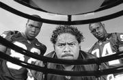 Kansas defensive end Monroe Weekley, above left, defensive tackle Phil Tuihalamaka and defensive end Chuck Jones at KU media day.