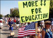 Advocates of increased school funding march down Massachusetts Street chanting slogans and holding signs. Saturday's demonstration, which started in Buford M. Watson Jr. Park, concluded in South Park. The group included public officials, students, educators, parents and taxpayers.