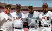 From Left, Willie Mays, bobby bonds, Andre Dawson and Barry Bonds pose during a ceremony honoring the four members of the 300 home runs-300 stolen bases club in San Francisco, in this April 28, 1996 photo. Bonds died Saturday in San Francisco. He was 57.