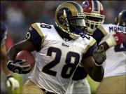 St. Louis running back marshall faulk carries the ball during the first quarter. The Buffalo Bills beat the Rams, 28-24, Saturday, in Orchard Park, N.Y.