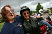 Bonnie Kiefer, left, shares a laugh with fellow motorcyclist Pat Pinskey, right, 72, from Bristol, R.I. after a meeting of the Rethreads in Seekonk, Mass. Pinskey and Kiefer both are active members of the biking community.