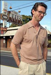 "Chuck Palahniuk, author of the newly released ""Fugitives and Refugees: A Walk in Portland, Oregon,"" stands outside his favorite tiki bar, The Alibi, in Portland, Ore."