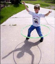 Joshua Evans, 9, keeps the hula-hoop moving around his hips.