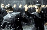 "Keanu Reeves, right, punches Hugo Weaving in a scene from the Warner Bros. Pictures movie ""The Matrix Revolutions."" The third film in the ""Matrix"" series hits theaters this fall."