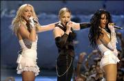 """Britney Spears, left, Madonna, center, and Christina Aguilera perform during the MTV Video Music Awards at New York&squot;s Radio City Music Hall. Spears and Aguilera joined Madonna&squot;s in singing """"Like a Virgin,"""" a throwback to the Material Girl&squot;s earth-shaking, erotic performance at the 1984 MTV awards show."""