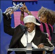 """Missy Elliott accepts the Best Hip-Hop Video of the Year award for """"Work It,"""" which also won Video of the Year."""