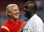 Kansas City Coach Dick Vermeil, left, jokes with St. Louis running back Marshall Faulk, one of Vermeil's former players. The Chiefs beat the Rams in their final preseason game, 22-6, Thursday in St. Louis.