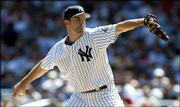 New York's Mike Mussina delivers against Chicago. Mussina won for the fifth time in six decisions as the Yankees defeated the White Sox, 7-5, Thursday in New York.