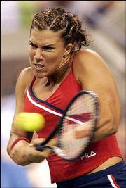 Jennifer Capriati returns a shot to Martina Sucha. Capriati won, 6-1, 6-1, at the U.S. Open Thursday night in New York.
