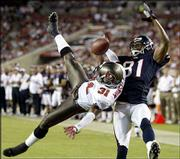 Tampa Bay cornerback Tim Wansley (31) breaks up a pass intended for Houston wide receiver Atnaf Harris. The Buccaneers beat the Texans, 34-3, Thursday in Tampa, Fla.