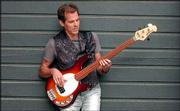Stan Shelton, an Ottawa native, leaves today for Russia. Shelton is playing bass behind bluesman Jimmy D. Lane.