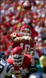 Kansas City Chiefs quarterback Trent Green makes a completion to running back Omar Easy in the third quarter of their game against the San Diego Chargers.
