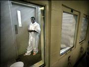 Charles McKinley waits between interviews with the media at the Suzanne Kays Jail in Dallas. McKinley had himself shipped from New York to Dallas in an airline cargo crate to his parents' home. McKinley, 25, a shipping clerk from New York, was arrested on unrelated bad-check and traffic warrants.