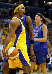 Los Angeles' tamecka dixon, a Kansas University product, reacts to a basket. The Sparks beat the Detroit Shock, 75-63, in the WNBA Finals Friday night in Los Angeles.