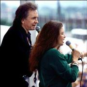 Music legend Johnny Cash, left, performs with his wife, June Carter Cash, in June 1992 in Nashville, Tenn. Johnny Cash died Friday from complications from diabetes, four months after June Carter Cash died.
