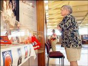 Rodney Gillespie, of San Antonio, looks at an exhibit at the Robert J. Dole Institute of Politics. Lawrence tourism officials said Monday that they would like to market a tour package to motorcoach and bus associations. The tour package would include stops at the Dole Institute on Kansas University's west campus, the Eisenhower Presidential Library in Abilene and the Truman Presidential Library in Independence, Mo.