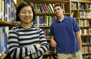 Ying Niu, left, and Jamie Huston are Lawrence High School's National Merit Scholarship semifinalists. Niu is the daughter of Fenghui Niu and Wei Zhou, and Huston is the son of John and Melinda Huston.