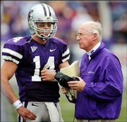 Kansas State quarterback Jeff Schwinn, left, a McLouth native, chats with coach Bill Snyder during a timeout Saturday against Massachusetts. Schwinn, who replaced injured Ell Roberson against UMass, could start again this Saturday.