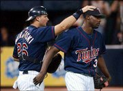 Minnesota catcher A.J. Pierzynski, left, congratulates reliever LaTroy Hawkins after the Twins' victory over Chicago. The Twins defeated the White Sox, 5-2, Tuesday night in Minneapolis.