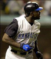 Kansas City's Rondell White rounds the bases after hitting a three-run home run. The Royals defeated the Indians, 12-8, Tuesday night in Cleveland.
