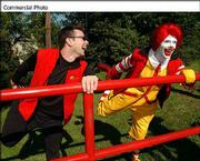 Bob Greene, left, personal trainer for Oprah Winfrey, and Ronald McDonald stretch before a walk on the Monon Trail in Indianapolis. McDonald's announced an exclusive partnership with Greene, an exercise physiologist, to educate the public about eating healthy.