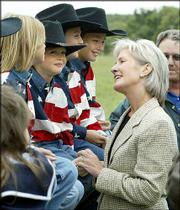 Kansas Gov. Kathleen Sebelius visits with, from left, Sadia Coonrod, 7, Nicholas Ackley, 6, Tyler Coonrod, 11, and Cory Coonrod, 10, before lunch at the Coonrod's ranch outside Longton. Sebelius was on the Kansas Farm Bureau's annual governor's farm tour Thursday afternoon.