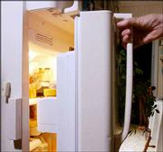 Mary, 74, opens her refrigerator, which has a sensor on the left to record and relay the opening and closing of the door, in her in home in Albany, N.Y. General Electric's home assurance system allows Mary's children to see what their mother is doing by going to a secure Internet site. The refrigerator is monitored to make certain that senior citizens are getting food on a regular basis.