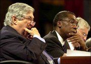 World Bank President James Wolfensohn, left, yawns during the last meeting of the Boards of Governors of the International Monetary Fund and World Bank in Dubai, United Arab Emirates. At right is Ofosu Amaah, board secretary of the World Bank.