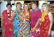 From left, Mary Beth Swenson, Lawrence; Joan Walker, Sioux City, Iowa; Helen Cox, Lawrence; Phyllis Hertling, Lawrence; and Linda Hermes, Lawrence; attend the River City Cosmopolitan Club's 2003 Inaugural Luau.