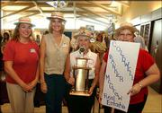 Coldwell Banker McGrew Real Estate employees tout the Pacesetter Award that they were given during the kickoff celebration of the United Way of Douglas County 2003-2004 campaign. From left are Carrie Sinks, Nancy Breithaupt, Mary Jones and Jolene Cole. Peoples Bank also received a Pacesetter Award during the event Sept. 17 at the Dole Institute of Politics.