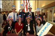 U.S. Bank employees attend the kickoff celebration of the United Way of Douglas County 2003-2004 campaign at the Dole Institute of Politics on Kansas University's west campus. Back row, from left, are Ferren Taylor, Tony Thornton, Doug Dawson and Chuck Warner; front row, from left, are Joan Golden, Lindsay Morrissey, Debbie Heinrich and Lisa Harris. The event was Sept. 17.