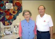 Ned and Betty Cushing pose for a picture during the Lawrence Presbyterian Manor's Soup and Pie Supper and Auction. The Cushings were looking over items for the live auction, which was Sept. 16 at the manor. Ned Cushing is a member of the manor's golf committee. About 400 people attended the fund-raiser for the manor's Good Samaritan program.