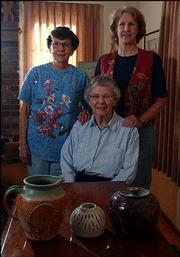 From left, Helen Martin, Betty Lessenden and Betty Gates are Lawrence potters who will showcase their work Saturday during the Lawrence Potter's Guild annual sale at the Lawrence Arts Center, 940 N.H. The women displayed some of their favorite pieces recently at Lessenden's west Lawrence home.