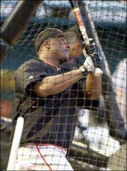 San Francisco's Barry Bonds takes batting practice. Bonds was preparing Thursday for today's game at ProPlayer Stadium in Miami. The Giants will face Florida in Game 3 of their NL division series.