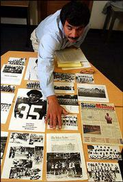 Mike Tosee, an American Indian studies instructor at Haskell Indian Nations University, points out a basketball photo of the Murphy triplets. The Murphy brothers -- Harold, Ronald and Donald -- are among former Haskell athletes and coaches whose achievements will be celebrated Saturday during the school's homecoming. They will be featured in a new exhibit at Haskell's Cultural Center and Museum.