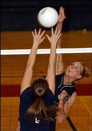 Free State's Jamie Stanclift spikes the ball against an Olathe East player during the Lawrence High quadrangular. FSHS went 0-3 at the quad Thursday at LHS.